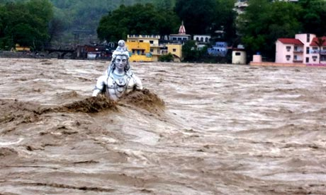 Catastrophic floods in the Himalayan region of India killed thousands of people and destroyed countless structures and natural habitat. As Vandana Shiva discussed during a recent interview,  the severity of these floods is in large part due to irresponsible hydropower and development projects greenlighted by a corrupt government. Photograph: Indian Photo Agency/Rex Features
