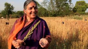 Vandana Shiva has founded non-profit organizations, community-based movements, and an Earth Institute dedicated to promoting local, sustainable agriculture. Here she is seen promoting  seed saving as an act of self-sufficiency and defiance against the corporate takeover of food production. Image credit: the Canadian Daily.