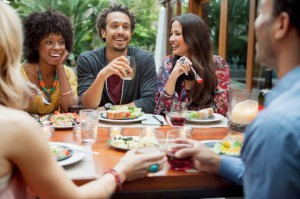 Enjoying a meal with friends or family can boost your mood and result in a healthier mind and body than eating alone or in a rush.